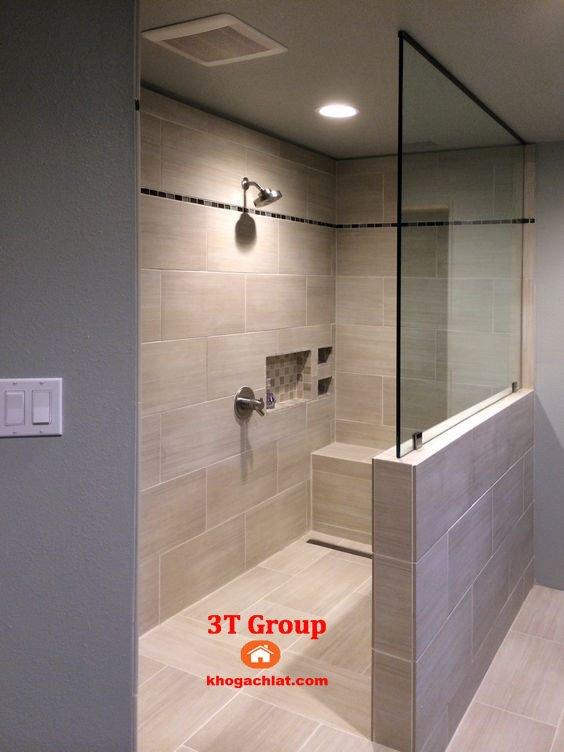 Ốp tường phòng vệ sinh bằng gạch 30x60 men khô màu kem vàng