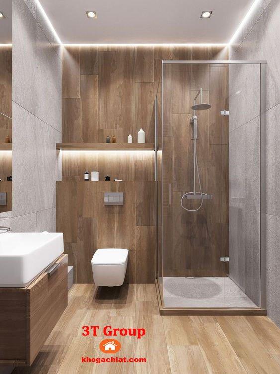 Ốp tường phòng vệ sinh bằng gạch giả gỗ kết hợp gạch 60x60 vân xi măng